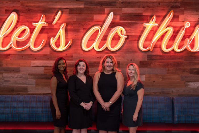 Founder and CEO Mary Fusillo with the 3 Sisters Surrogacy team